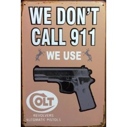 "Plaque vintage ""We don't call 911, we use Colt"""